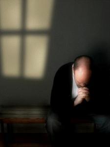 Man-praying-alone